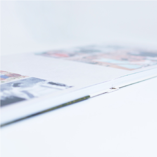 side view of quality layflat photo book with leather cover